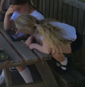 Girls outside with iPads